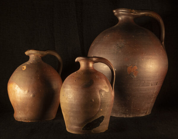 three Rustic French redware jug