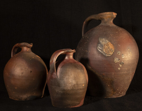 three Rustic French redware jug